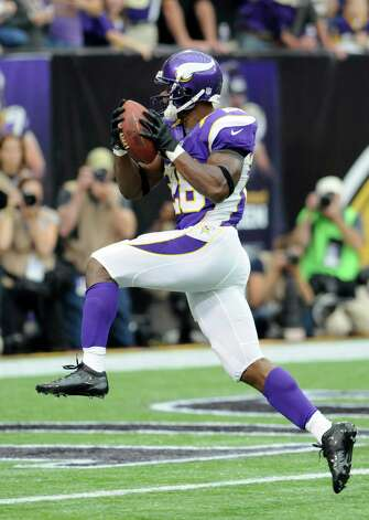 Minnesota Vikings running back Adrian Peterson leaps to the end zone as he scores a touchdown during the first half against the Jacksonville Jaguars, Sunday, Sept. 9, 2012, in Minneapolis.  Photo: Jim Mone, Associated Press / AP