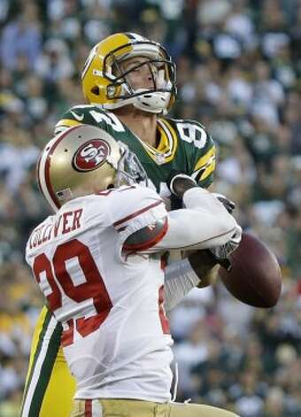San Francisco 49ers' Chris Culliver (29) breaks up a pass intended for Green Bay Packers' Jordy Nelson during the second half of an NFL football game Monday, Sept. 10, 2012, in Green Bay, Wis. (AP Photo/Morry Gash)
