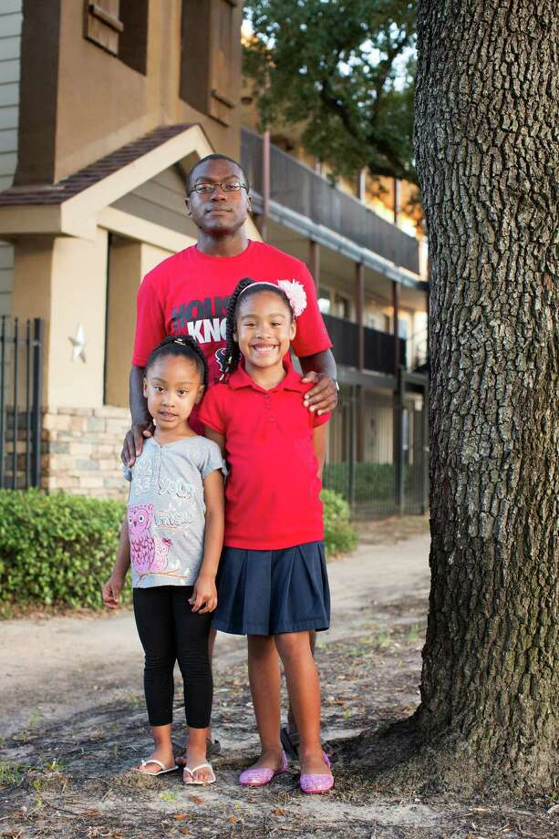 "Chester Brown Jr. - shown with his daughters Celena, 5, left, and Chelsea, 6 - says his landlord has informed him that his rent's going up again. It went up $150 a month last fall, and Brown's landlord said ""the market price for that unit is $1,100"" a month. Photo: TODD SPOTH / © TODD SPOTH, 2012"