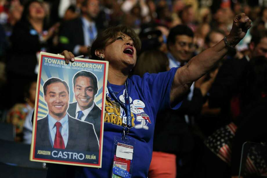 An admirer makes her feelings known as she holds aloft a photo of San Antonio Mayor Julián Castro and his brother, Joaquin, on the final day of the Democratic National Convention. Photo: Tom Pennington / 2012 Getty Images