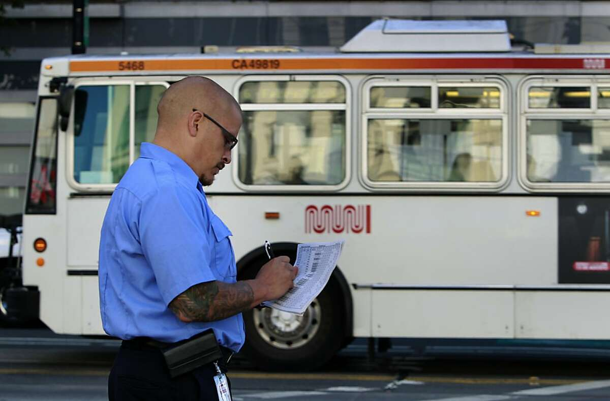 Muni street inspector Marcus Marcic logs the arrival time of an inbound bus at the corner of Van Ness Avenue and Market Street in San Francisco, Calif. on Friday, Sept. 7, 2012.