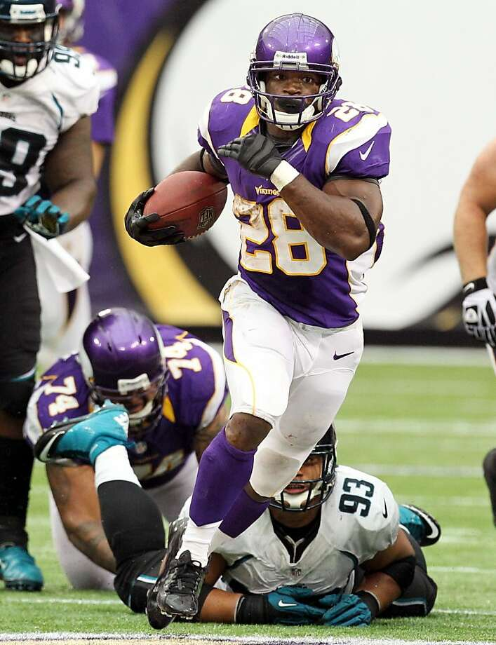 Minnesota's Adrian Peterson was still going strong in overtime. Photo: Genevieve Ross, Associated Press