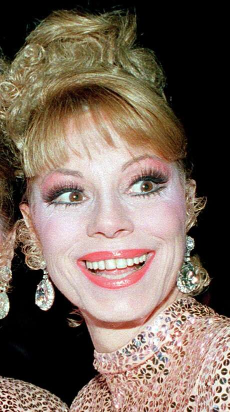 FILE - Singer Dorothy McGuire, seen here in a file photo taken Thursday, Oct. 10, 1986, poses outside Radio City Music Hall in New York City. McGuire, of the popular 1950s musical trio, the McGuire Sisters, has died of natural causes at the age of 84 in the Phoenix, Ariz., area Friday. (AP Photo/Ed Bailey, File) Photo: ED BAILEY / AP