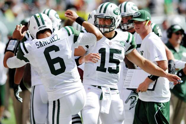 New York Jets quarterbacks Mark Sanchez, left, and Tim Tebow celebrate after a touchdown during the second half of an NFL football game against the Buffalo Bills at MetLife Stadium, Sunday, Sept. 9, 2012, in East Rutherford, N.J. (AP Photo/Bill Kostroun) Photo: Bill Kostroun