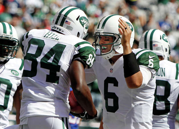 New York Jets quarterback Mark Sanchez celebrates with wide receiver Stephen Hill after Hill scored a touchdown during the first half of an NFL football game against the Buffalo Bills at MetLife Stadium, Sunday, Sept. 9, 2012, in East Rutherford, N.J. (AP Photo/Mel Evans) Photo: Mel Evans