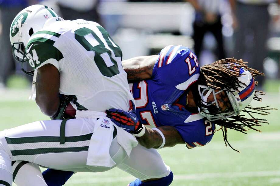 Buffalo Bills cornerback Stephon Gilmore, right, tackles New York Jets wide receiver Stephen Hill during the first half of an NFL football game at MetLife Stadium, Sunday, Sept. 9, 2012, in East Rutherford, N.J. (AP Photo/Bill Kostroun) Photo: Bill Kostroun