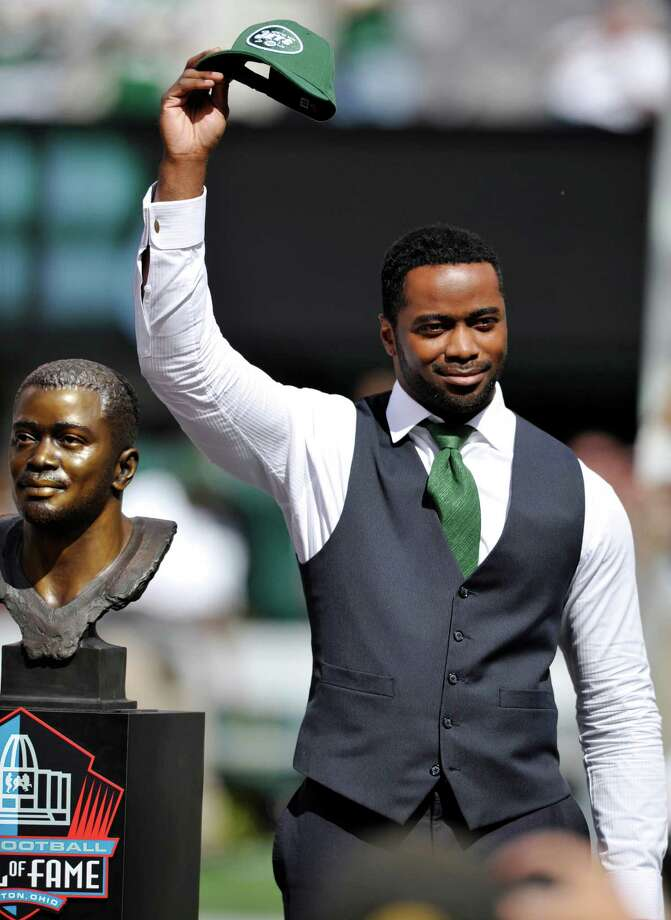Hall of Famer Curtis Martin acknowledges the fans as he is honored at halftime of an NFL football game between the New York Jets and the Buffalo Bills, Sunday, Sept. 9, 2012, in East Rutherford, N.J. (AP Photo/Bill Kostroun) Photo: Bill Kostroun