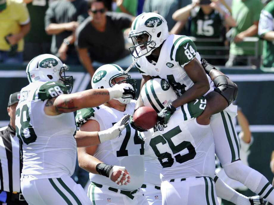 New York Jets wide receiver Stephen Hill (84) celebrates with teammates Matt Slauson (68) and Brandon Moore after scoring a touchdown during the first half of an NFL football game against the Buffalo Bills at MetLife Stadium, Sunday, Sept. 9, 2012, in East Rutherford, N.J. (AP Photo/Bill Kostroun) Photo: Bill Kostroun