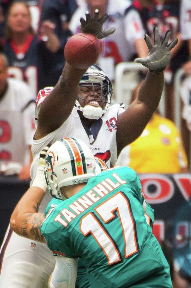 Texans defensive end Tim Jamison bats down a pass by Dolphins QB Ryan Tannehill, who was 20-0f-36 for 219 yards in his NFL debut. Photo: Smiley N. Pool / © 2012  Houston Chronicle