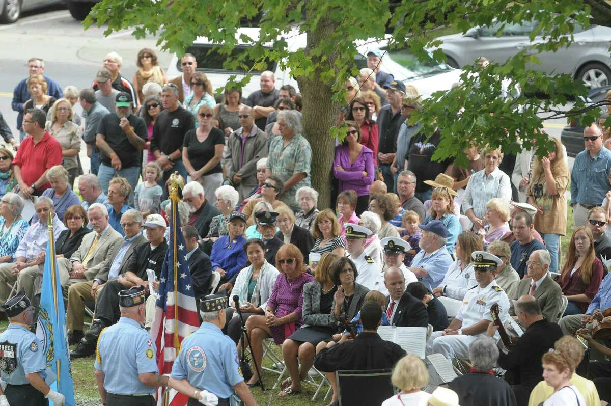 People gather at High Rock Park during a dedication ceremony for the 9/11 sculpture entitled