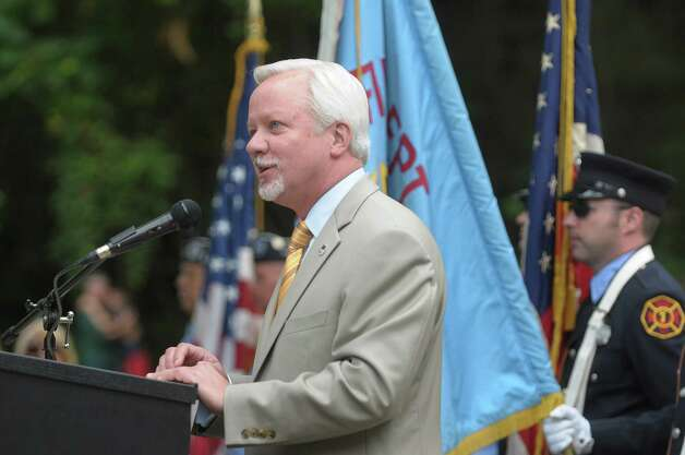 "Saratoga Springs Mayor Scott Johnson addresses those gathered during a dedication ceremony for the 9/11 sculpture entitled ""Tempered By Memory"", on Sunday, Sept. 9, 2012 at High Rock Park in Saratoga Springs, NY.  The sculpture is made of World Trade Center steel.   (Paul Buckowski / Times Union) Photo: Paul Buckowski"