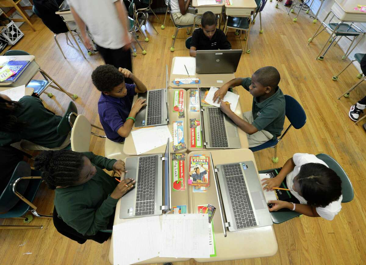 Students use their laptops at the Ark Community Charter School in Troy, N.Y. Sept. 7, 2012. (Skip Dickstein/Times Union)