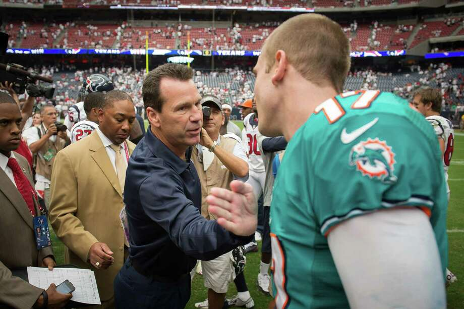 A couple of former Texas A&M quarterbacks share good wishes and a lifelong connection as Texans coach Gary Kubiak, left, meets with Dolphins rookie quarterback Ryan Tannehill after Sunday's game at Reliant Stadium. Photo: Smiley N. Pool / © 2012  Houston Chronicle