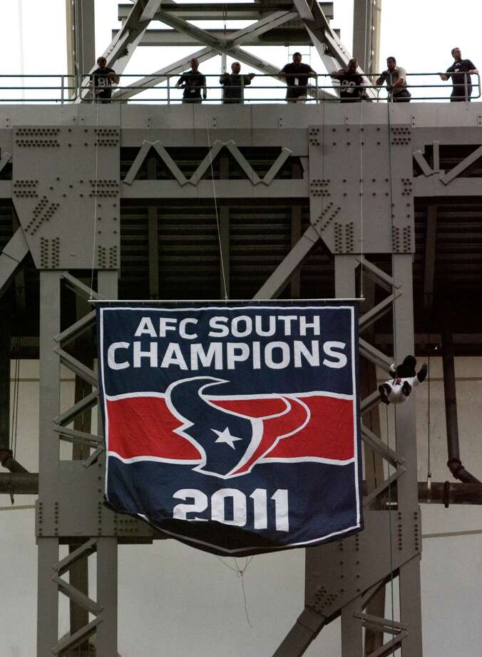 A 2011 AFC South Champions banner is unfurled before the Houston Texans face the Miami Dolphins in the season opener at Reliant Stadium, Sunday, Sept. 9, 2012, in Houston. ( Nick de la Torre / Houston Chronicle ) Photo: Nick De La Torre / © 2012  Houston Chronicle