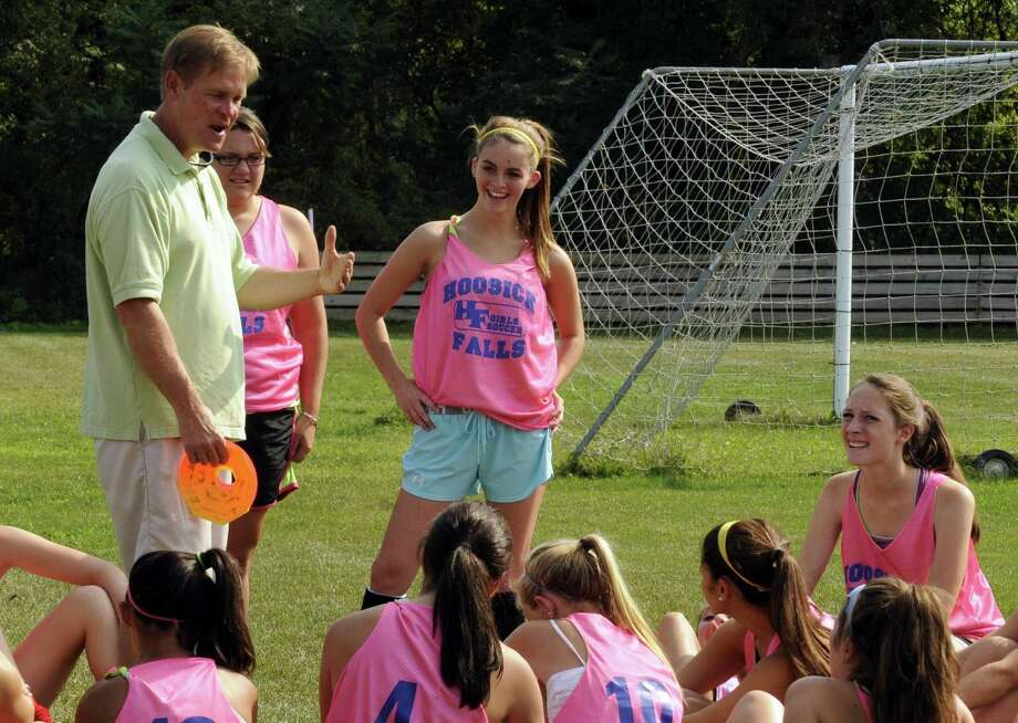 Head coach Tom Husser, left, puts the Hoosick Falls High School girls' soccer team through a practice in Hoosick Falls, NY Friday Sept. 7, 2012. (Michael P. Farrell/Times Union) Photo: Michael P. Farrell