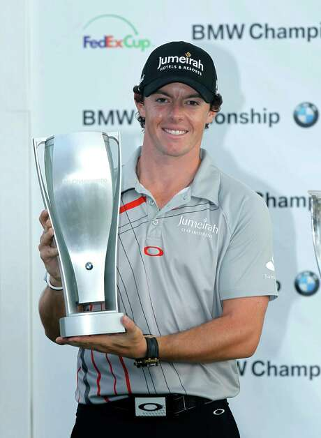 Rory McIlroy of Northern Ireland poses with the BMW trophy after winning the BMW Championship PGA golf tournament at Crooked Stick Golf Club in Carmel, Ind., Sunday, Sept. 9, 2012. (AP Photo/Charles Rex Arbogast) Photo: Charles Rex Arbogast / AP