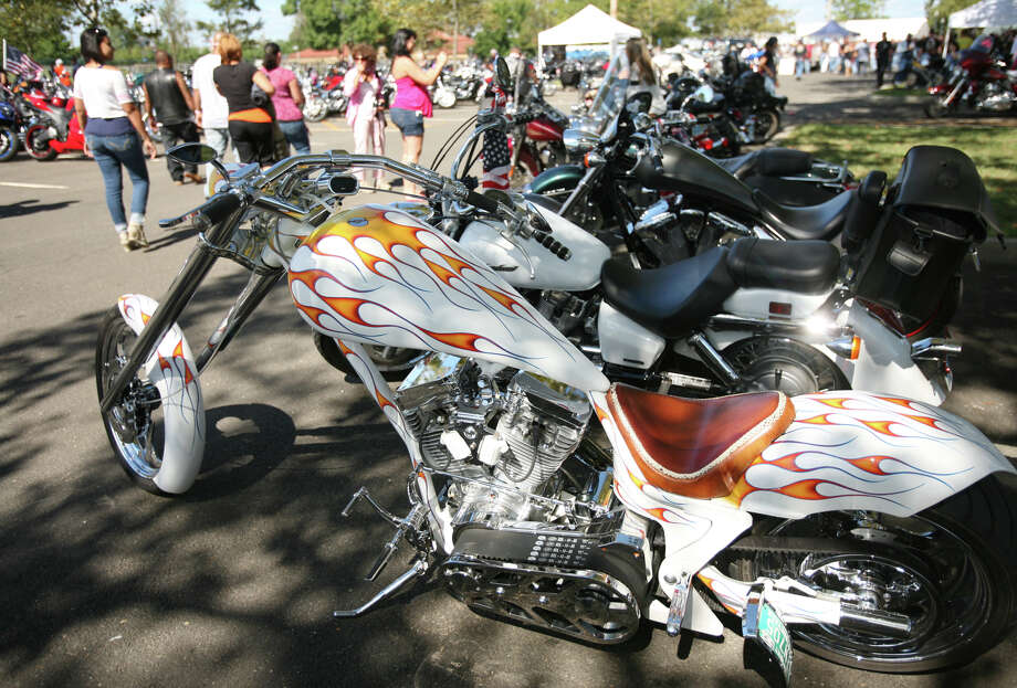 A custom chopper is one of thousands of motorcycles at Seaside Park in Bridgeport following the 12th Annual CT United Ride from Norwalk to Bridgeport on Sunday, September 9, 2012. Photo: Brian A. Pounds / Connecticut Post