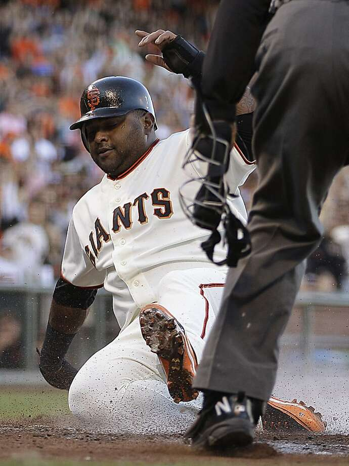 San Francisco Giants' Pablo Sandoval slides to score against the Los Angeles Dodgers in the first inning of a baseball game, Sunday, Sept 9, 2012, in San Francisco. Sandoval scored on a double by Giants' Hunter Pence. (AP Photo/Ben Margot) Photo: Ben Margot, Associated Press