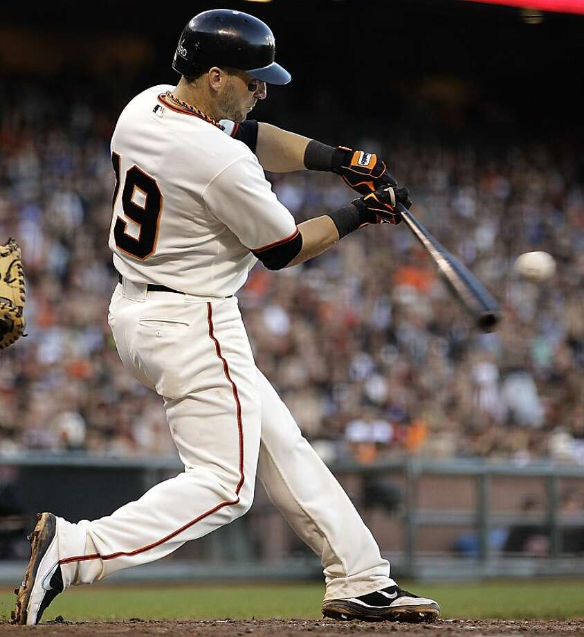 San Francisco Giants' Marco Scutaro connects for an RBI sacrifice fly off Los Angeles Dodgers' Joe Blanton in the inning of a baseball game, Sunday, Sept. 9, 2012, in San Francisco. (AP Photo/Ben Margot) Photo: Ben Margot, Associated Press