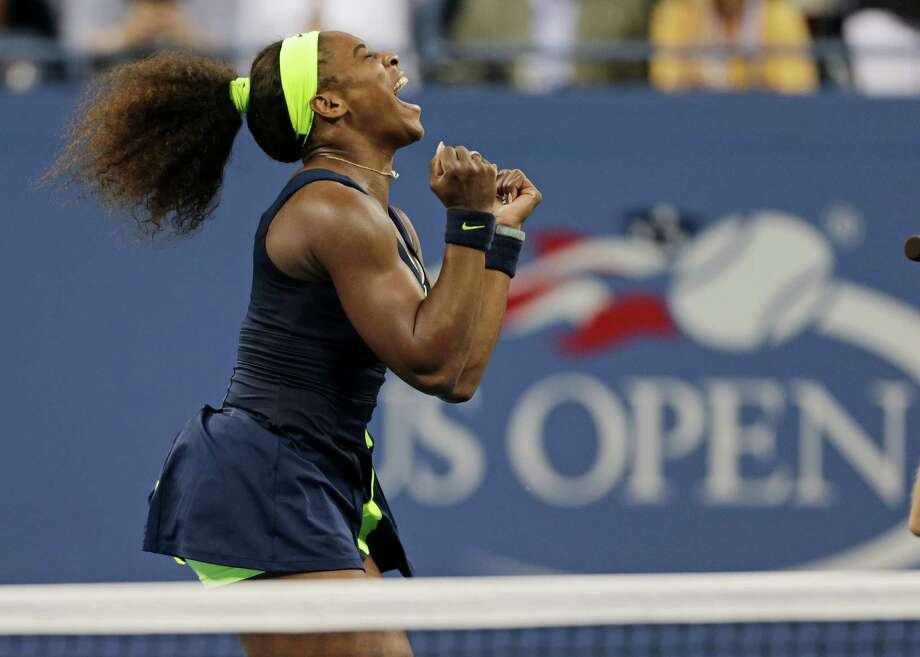 Serena Williams savors a Grand Slam championship she had to work hard to achieve Sunday, winning 7-5 in the third set against top-ranked Victoria Azarenka. Photo: Charles Krupa / AP