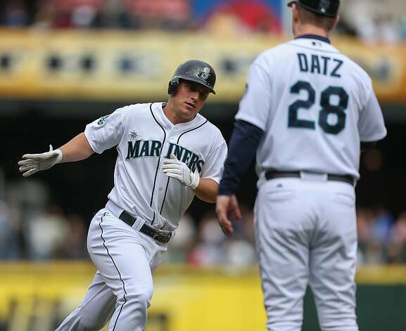 SEATTLE, WA - SEPTEMBER 09:  Kyle Seager #15 of the Seattle Mariners is congratulated by third base coach Jeff Datz #28 after hitting a home run against the Oakland Athletics at Safeco Field on September 9, 2012 in Seattle, Washington.  (Photo by Otto Greule Jr/Getty Images) Photo: Otto Greule Jr, Getty Images