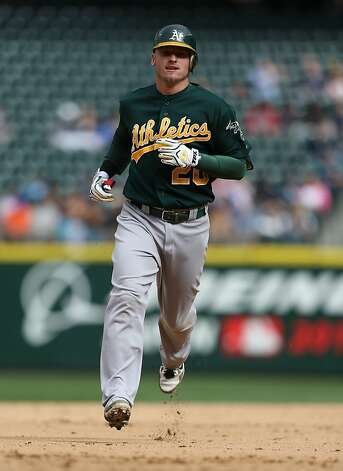 SEATTLE, WA - SEPTEMBER 09:  Josh Donaldson #20 of the Oakland Athletics rounds the bases on a home run in the ninth inning against the Seattle Mariners at Safeco Field on September 9, 2012 in Seattle, Washington.  (Photo by Otto Greule Jr/Getty Images) Photo: Otto Greule Jr, Getty Images