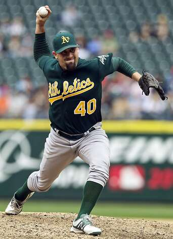 Oakland Athletics reliever Pat Neshek delivers against the Seattle Mariners during a baseball game at Safeco Field in Seattle, Sunday, Sept. 9, 2012. The Athletics won 4-2. (AP Photo/Stephen Brashear) Photo: Stephen Brashear, Associated Press