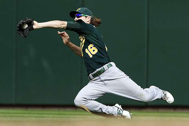 Oakland Athletics outfielder Josh Reddick makes a diving catch in the ninth inning of a baseball game against the Seattle Mariners at Safeco Field in Seattle, Sunday, Sept. 9, 2012. The Athletics won 4-2. (AP Photo/Stephen Brashear) Photo: Stephen Brashear, Associated Press
