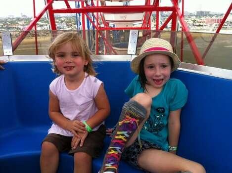 Riding the Ferris wheel at Pleasure Pier.