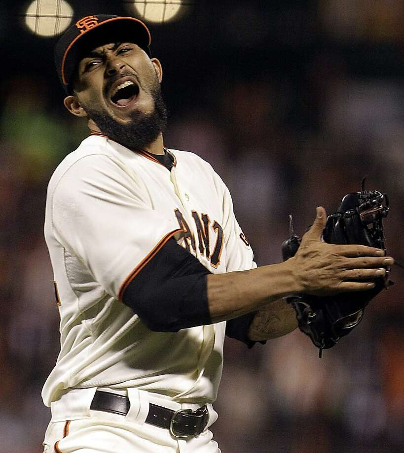San Francisco Giants' Sergio Romo celebrates as the final out is made against the Los Angeles Dodgers in the ninth inning of a baseball game, Sunday, Sept. 9, 2012, in San Francisco. The Giants won 4-0. (AP Photo/Ben Margot) Photo: Ben Margot, Associated Press