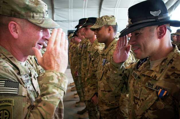 PARWAN PROVINCE, Afghanistan - U.S. Army Col. T.J. Jamison, 82nd Combat Aviation Brigade commander, of Broken Arrow, Okla., awards Chief Warrant Officer 2 Jose Montenegro, Jr., of San Juan, Texas, with the Air Medal Aug. 30, 2012, on Bagram Airfield, Afghanistan. Montnegro, an OH-58D Kiowa Warrior pilot assigned to Troop F, 1-17 Air Cavalry Regiment, 82nd Combat Aviation Brigade, 82nd Airborne Division, was killed when his helicopter crashed in Logar Province, Afghanistan, Sept. 5, 2012.  (U.S. Army photo by Sgt. 1st Class Eric Pahon) Photo: Sgt. 1st Class Eric Pahon, Courtesy / U.S. Army