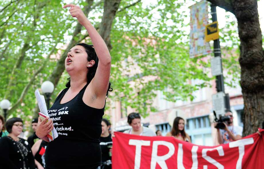 Emma Kaplan performs a poem at Occidental Park before the Seattle SlutWalk march on Sunday, Sept. 9, 2012. The annual march, which began this year in Occidental Park and ended at Westlake Park, protests blaming the victims of rape and sexual assault on the basis of their appearance. Photo: LINDSEY WASSON / SEATTLEPI.COM