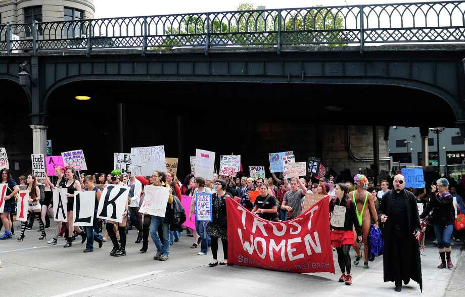 Seattle SlutWalk 2012 marches out from under Yesler Way. Photo: LINDSEY WASSON / SEATTLEPI.COM