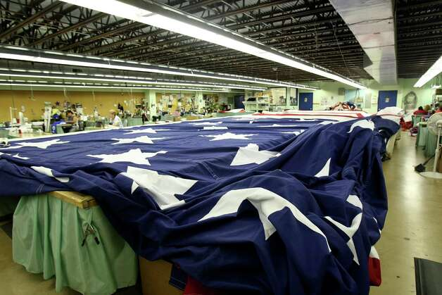 New York's Port Authority selected San Antonio's Dixie Flag Manufacturing Company to make a 60 ft. by 90 ft. American flag for the World Trade Center Memorial dedication ceremony on Sept. 11. Photo: Helen L. Montoya, SAN ANTONIO EXPRESS-NEWS / SAN ANTONIO EXPRESS-NEWS
