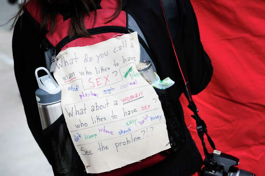 A woman's sign protests the difference between perceptions of men and women. Photo: LINDSEY WASSON / SEATTLEPI.COM