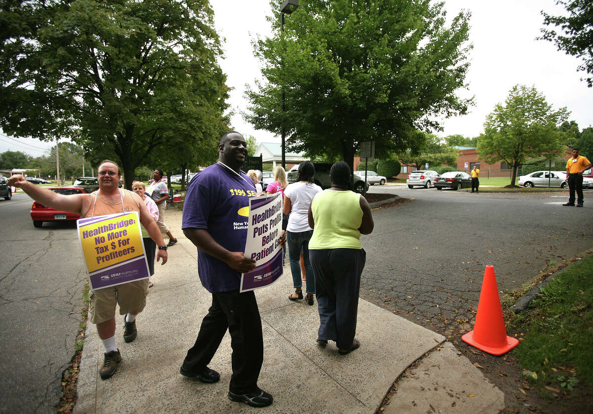 Healthcare union workers picket in front of West River Health Care at 245 Orange Avenue in Milford on Thursday, September 6, 2012. The workers have been on strike for months, after refusing what they see as an unfair contract offer by the nursing home's owner, HealthBridge.
