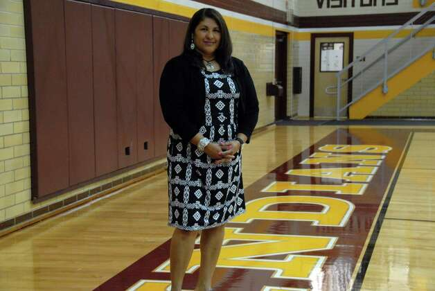 Coach Sylvia Cardenas has built a winning volleyball program at Harlandale. The coach recently celebrated her 500th victory. Photo: Courtesy Photo