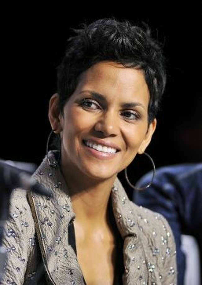 "Actress Halle Berry smiles during the press conference for the film ""Cloud Atlas."" (ASSOCIATED PRESS)"