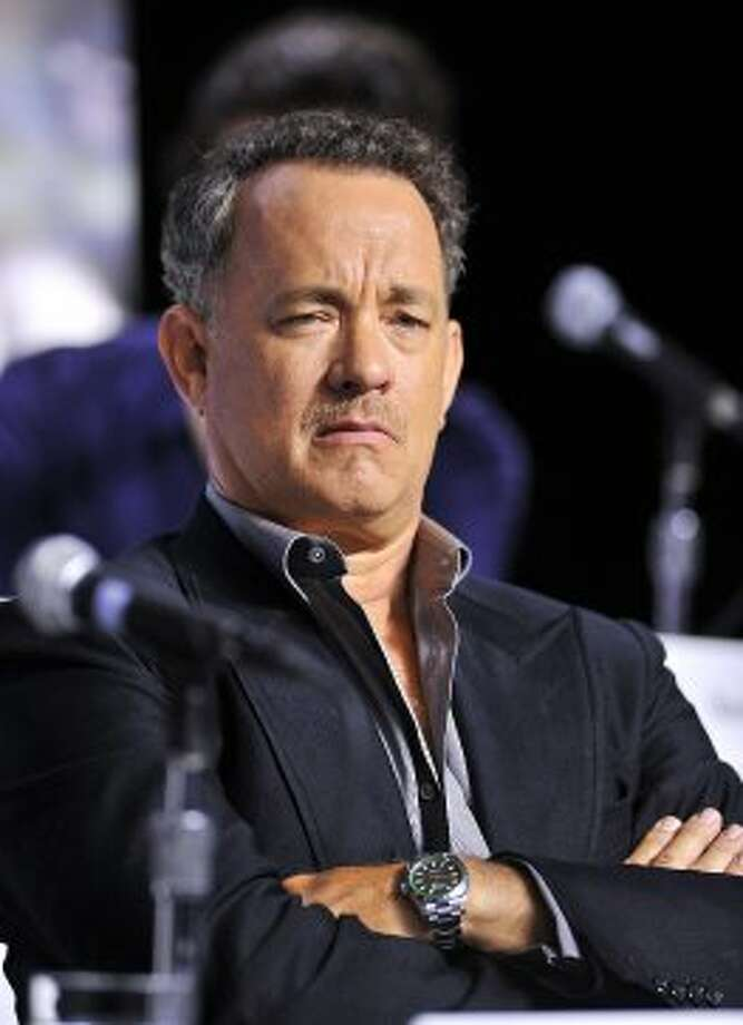 "Actor Tom Hanks listens during the press conference for the film ""Cloud Atlas."" (ASSOCIATED PRESS)"
