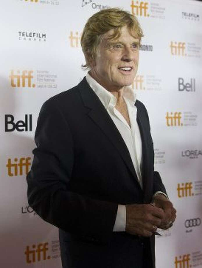 "Actor/director Robert Redford poses for photographs on the red carpet for the new movie ""The Company You Keep."" (AP)"