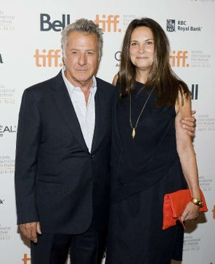 "Director Dustin Hoffman poses for a photo with his wife Lisa on the red carpet at the Elgin Theatre for the film ""Quartet."" (AP)"