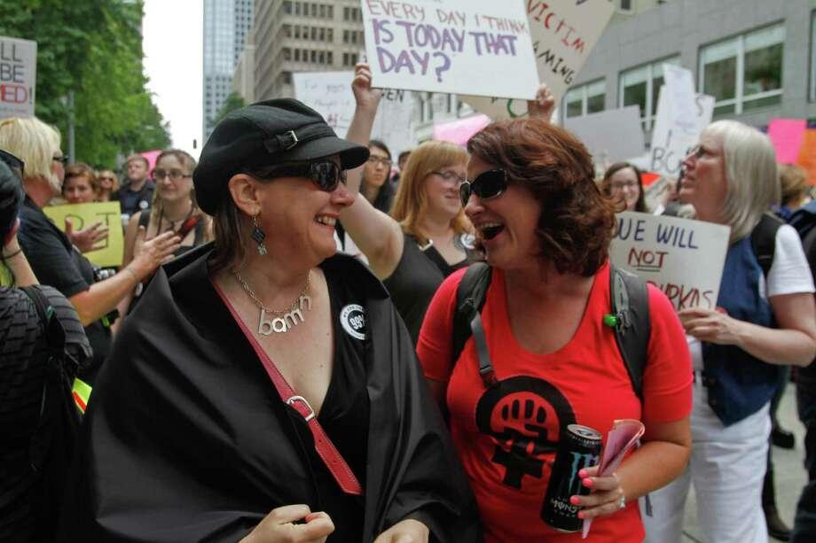 Two women share a laugh. Photo: Sofia Jaramillo / SEATTLEPI.COM