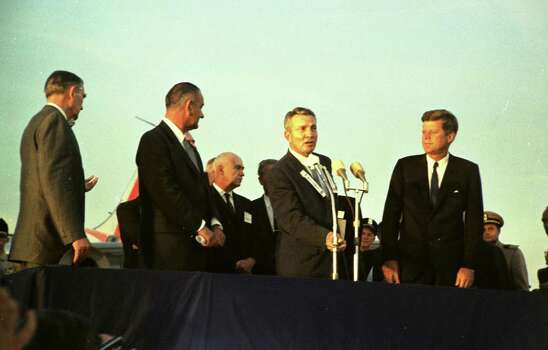 09/11/1962 - President John F. Kennedy arrives at International Airport in Houston to huddle with NASA's leadership and address a national audience from Rice to bolster his initiative to land American astronauts on the moon. President Kennedy is greeted at the airport by Mayor Lewis Cutrer while U.S. Rep. Albert Thomas, Vice President Lyndon Johnson and other dignitaries listen. Photo: Houston Chronicle / Houston Chronicle