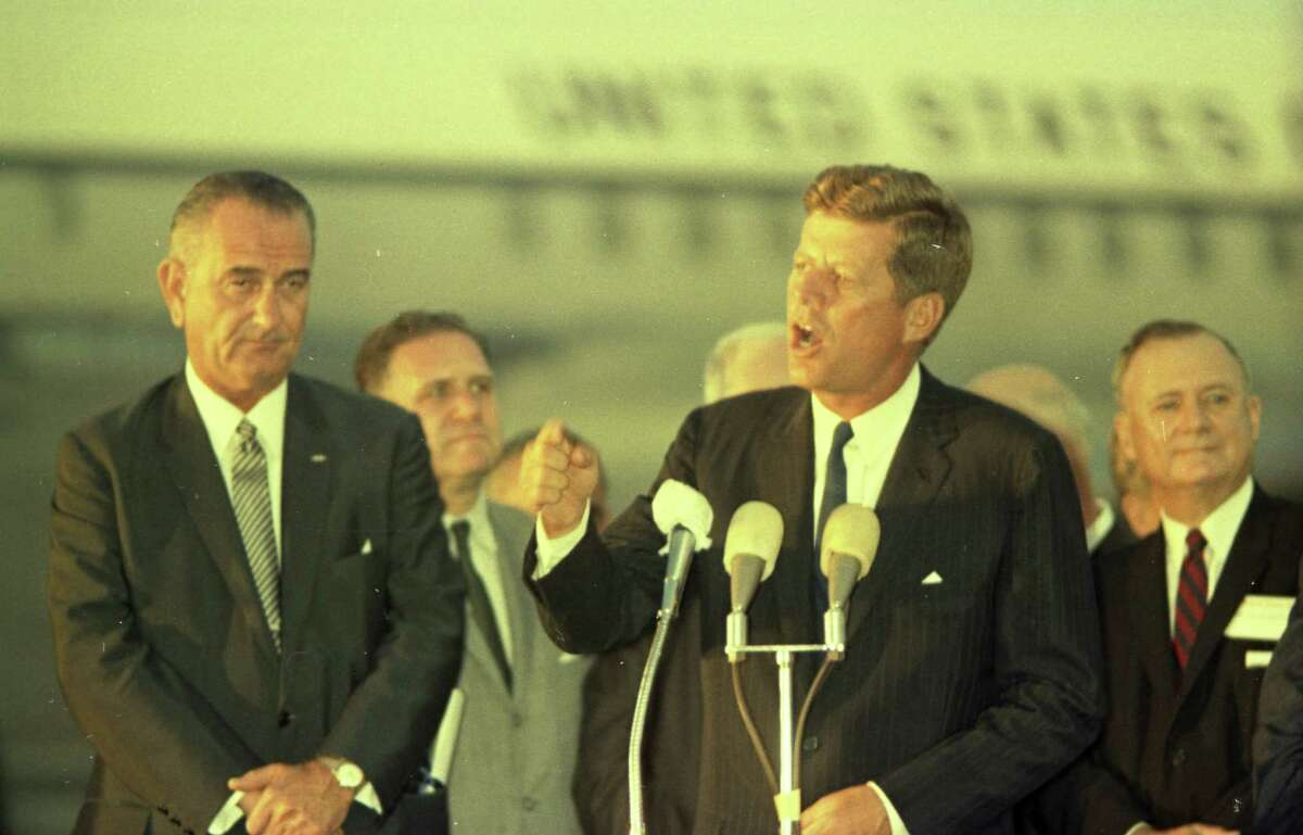 09/11/1962 - President John F. Kennedy arrives at International Airport in Houston to huddle with NASA's leadership and address a national audience from Rice to bolster his initiative to land American astronauts on the moon. President Kennedy speaks at the airport while Vice President Lyndon Johnson and other dignitaries listen.