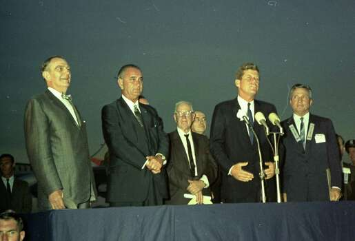 09/11/1962 - President John F. Kennedy arrives at International Airport in Houston to huddle with NASA's leadership and address a national audience from Rice to bolster his initiative to land American astronauts on the moon. President Kennedy speaks at the airport. L-R  U.S. Rep. Albert Thomas, Vice President Lyndon Johnson, unidentified man, President Kennedy, Houston Mayor Lewis Cutrer. Photo: Houston Chronicle / Houston Chronicle