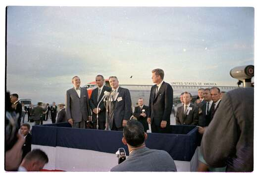 09/11/1962 - President John F. Kennedy arrives in Houston to huddle with NASA's leadership and address a national audience from Rice to bolster his initiative to land American astronauts on the moon. President Kennedy is greeted at the airport by Mayor Lewis Cutrer while U.S. Rep. Albert Thomas, Vice President Lyndon Johnson and other dignitaries listen. Photo: Houston Chronicle / Houston Chronicle