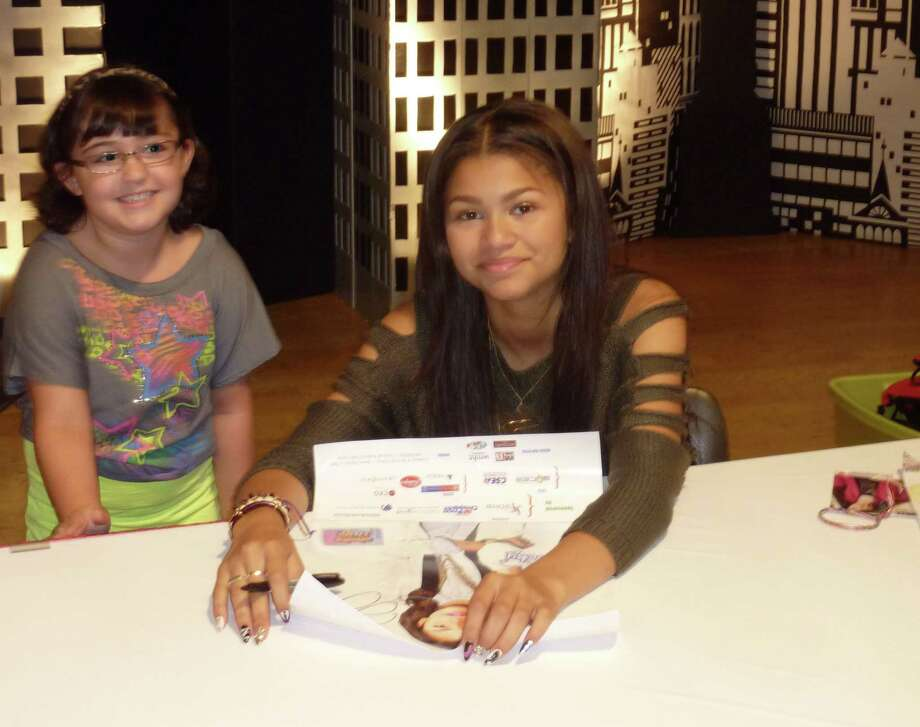 Zendaya Coleman (Rocky) signs an autograph for Sophia Arduini. 2012 Back to School Expo at the Empire State Plaza. Photo by Geoffrey Flynn. Photo: Anne-Marie Sheehan