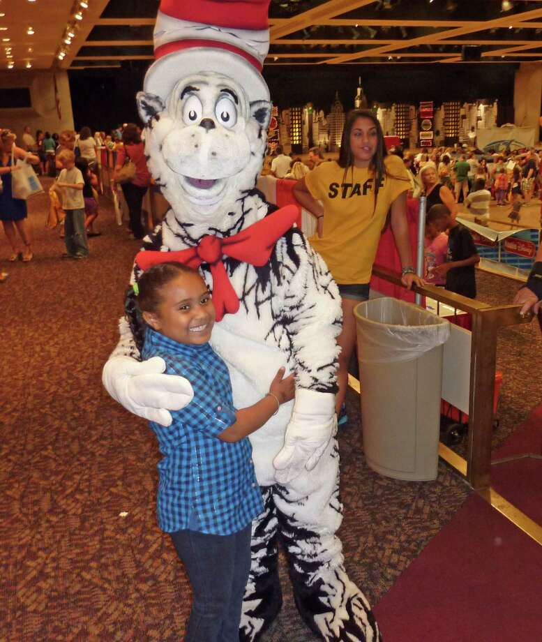 Kaylenna Maynard poses with the Cat in the Hat. 2012 Back to School Expo at the Empire State Plaza. Photo by Geoffrey Flynn. Photo: Anne-Marie Sheehan