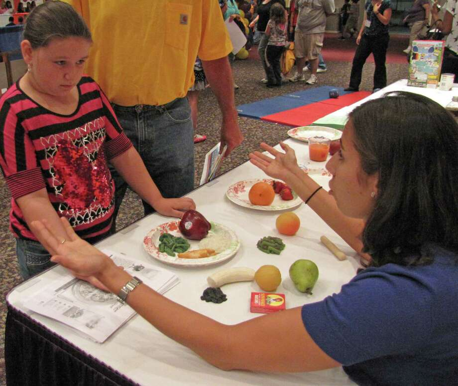 "Alexandra Vandenburgh, a 3rd grader from Pine Bush Elementary School, learns about nutrition and making a ""healthy plate"" at the Albany Medical Center booth. 2012 Back to School Expo at the Empire State Plaza. Photo by Anne-Marie Sheehan. Photo: Anne-Marie Sheehan"
