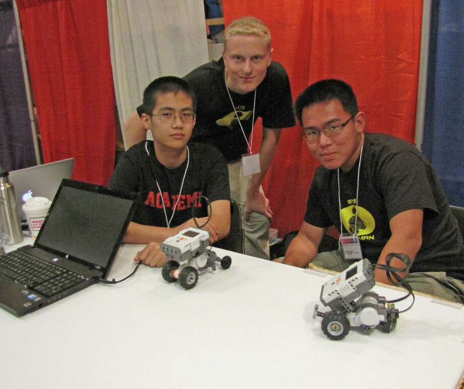 From left to right: Michael Zhang, 10th grade, A.J. Stair, 11th grade, and Andy Wu, 11th grade, from Albany Academy display their robotic vehicles. 2012 Back to School Expo at the Empire State Plaza. Photo by Anne-Marie Sheehan. Photo: Anne-Marie Sheehan